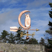 Owl in Moon Weathervane right rear view on gray sky background.