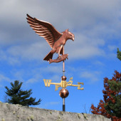 osprey weathervane right view on blue and cloudy sky background