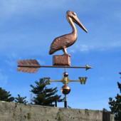 pelican weathervane angle right side on blue sky background