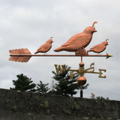 three quail weathervane angle right view on stormy background