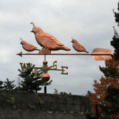 Three Quail Weathervane left side view on cloudy background