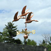 Three Geese Weathervane right side view on blue and cloudy sky background