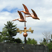 Three Geese Weathervane left side view on blue and cloudy sky background