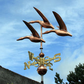 Three Flying Geese Weathervane left angle view on blue and cloudy sky background