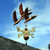 Three Flying Geese Weathervane front view on blue and cloudy sky background
