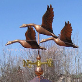 medium three flying geese weathervane left side view on blue sky background