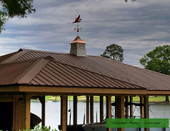 customer photo of our large blue heron on large gazebo cupola, right side view on stormy background