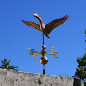 goose weathervane front view on blue sky background