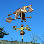 Flying Stork with Baby Weathervane right front view on blue sky background