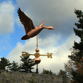 Flying Goose Weathervane front right side angle view on blue and cloudy sky background