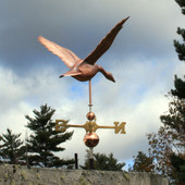 goose weathervane rear view on stormy sky background