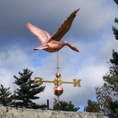 large flying goose weathervane right rear view on stormy sky background
