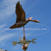 goose weathervane right side view on blue sky background