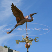 heron weathervane right side view on blue sky background