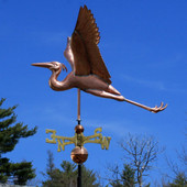 blue flying heron weathervane right side view on blue sky background