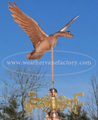 goose weathervane front angle view on blue sky background
