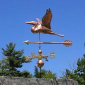 heron weathervane with arrow side view on blue sky image