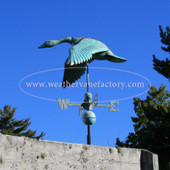 Flying Goose Weathervane shown in patina green with the wings down left angle view on blue sky background
