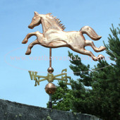 Jumping horse weathervane side image with blue sky background