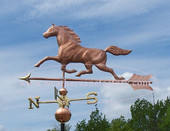 Horse weathervane side view image on blue sky background