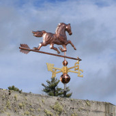 Running Horse Weathervane rear view on gray sky background