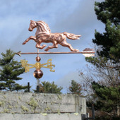 Horse Weathervane left view on gray sky background