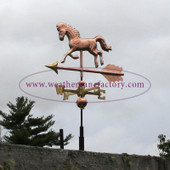 small horse weathervane image on stormy sky backround