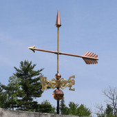 copper arrow weathervane left front view on blue sky background