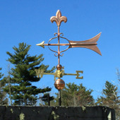 Fleur de Lis Arrow Weathervane left side view on blue sky background