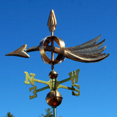 wind arrow weathervane left side view on blue sky background