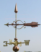 thick tail arrow weathervane left side view on blue sky