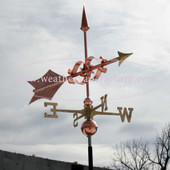 Large Fancy Arrow Weathervane frontal view on stormy sky background