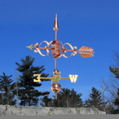 colonial arrow weathervane left side view on blue sky background