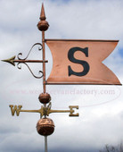 Big Banner Weathervane left side view with the letter S is shown with cloudy sky background