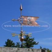 Skull and Crossbones Banner Weathervane  left side view on blue sky background.