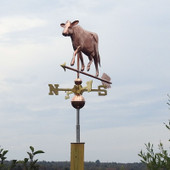 Cow Weathervane on gray sky background