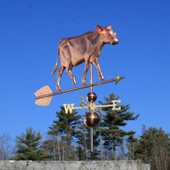 Large Cow Weathervane right front view on blue sky background