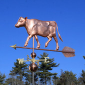 Large Cow Weathervane left front view on blue sky background