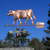 Large Cow Weathervane left side view on blue sky background
