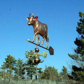 large cow with horns weathervane front view with blue sky background