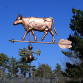 large cow with horns weathervane left side view with blue sky background