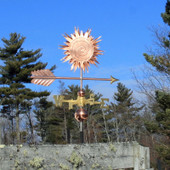 sun weathervane right side view on blue sky background
