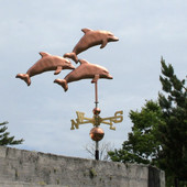 Three Dolphins Weathervane right side view on gray sky background