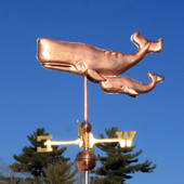 Two Whales Weathervane left side view on blue sky background