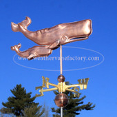 Two Whales Weathervane right side view on blue sky background