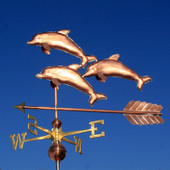 large three dolphins weathervane o blue sky background side view image