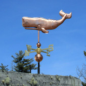 sperm whale weathervane left side view on blue sky background