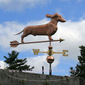 Dachshund Weathervane with ears flowing right front angle on blue and cloudy sky background