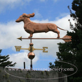 Dachshund Weathervane with ears flowing left front angle on blue and cloudy sky background