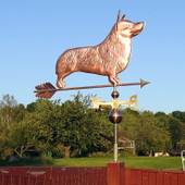 corgi weathervane right side view on blue sky background